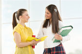 Happy Female students with books — Stock Photo