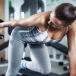 Young woman doing triceps exercise — Stock Photo #47245891
