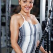Young woman doing triceps exercise — Stock Photo #47289529