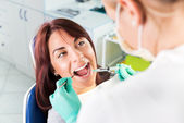Giving anesthesia to the patient before dental surgery — Stock Photo