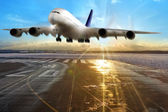Passenger airplane landing on runway in airport. Evening. — Stock Photo