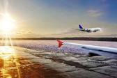 Passenger airplane landing on runway in airport. Evening — Stock Photo