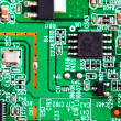 Close-up of electronic circuit board. Macro . - Stock Photo