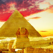 Stock Photo: Great Pyramid of Pharaoh Khufu, located at Giza and the Sphinx.
