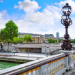 Pont Alexandre III bridge (1896) spanning the river Seine. Decor — Stock Photo #34972701