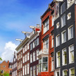 Amsterdam and typical houses with clear summer sky.Netherlands — Stock Photo