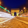Stock Photo: Evening on Champs-Elysees in front of Arc de Triomphe.Paris. Fra