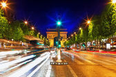 Evening on Champs-Elysees in front of Arc de Triomphe.Paris. Fra — Stock Photo