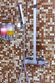 Modern designer tap and shower in bathroom — Stock Photo