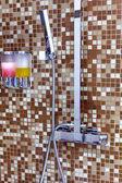 Modern designer tap and shower in bathroom — Stock Photo
