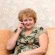 Senior lady speaks by a mobile phone. — Stock Photo #6512522