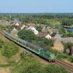 Landscape with the train, village and ri — Stock Photo #1888593