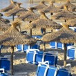 Sandy Beach With Straw Umbrellas and Sunbeds — Stock Photo #29222483