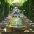 Fountain in the gardens of Hort del Rei — Stock Photo #29222583