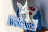 Donkey With Welcome Sign In Santorini — Stock Photo