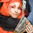Young lady with fan — Stock Photo #1909973