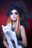 Young lady with cat. — Stock Photo