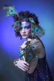 Woman in peacock image. — Stock Photo