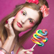 Girl with lollipop — Stock Photo #28744863