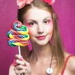 Girl with lollipop — Stock Photo #28913711