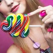 Girl with lollipop — Stock Photo #28913739