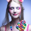 Girl with lollipop — Stock Photo #29002277
