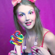 Girl with lollipop — Stock Photo #29023507