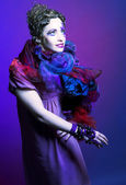 Woman in violet — Stock Photo