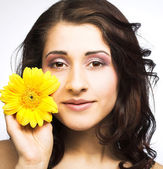 Woman with flower — Stock Photo