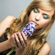 Girl with blue flower — Stock Photo