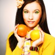 Young woman with fruits — Stock Photo