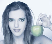 Young woman with green apple — Stock Photo