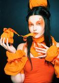 Girl orange. — Zdjęcie stockowe