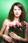 Woman with chrysanthemums — Stock Photo