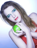 Girl with green apple — Stock Photo