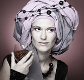 Young woman in violet turban — Stock Photo