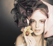 Young lady with orchids — Stock Photo