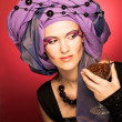 Stock Photo: Young womin violet turban