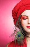 Woman in red turban — Stock Photo