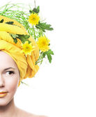 Girl and yellow flowers — Stock Photo