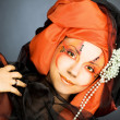 Young womin black and orange turban — Stock Photo #41306247