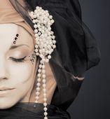 Young woman in black and orange turban — Stock Photo