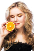 Young girl with orange — Stock Photo