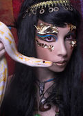 Woman with snake. — Stock Photo