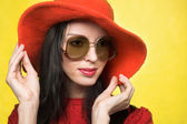 Vintage woman in sunglasses and red hat — Stock Photo