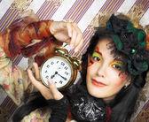 Girl with clock. — Стоковое фото