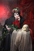 Woman with roses and skull — Stock Photo