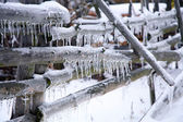 Fence with icicles — Stock Photo