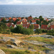 Gudhjem with red roofs by early morning, Bornholm, Denmark - Stock Photo