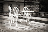 Old forgotten garden table and chairs — Stock Photo